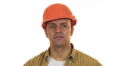 professionalism : Mature male constructionist in hardhat looking upset and disappointed
