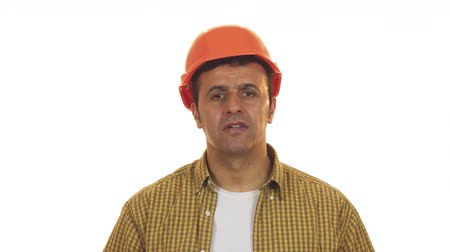 professionalism : Professional constructionist looking shocked taking off his hardhat
