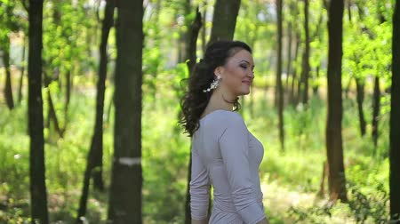 brown dress : woman in a light dress walking in a forest, park Stock Footage