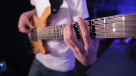 musicians stage : man playing bass guitar