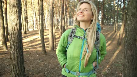 hiking : Hiker blonde woman walking hiking in forest with backpack.steadicam shot