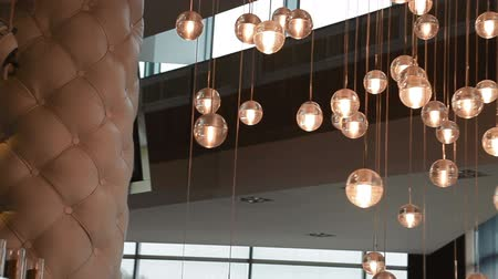 caffe : Lights of modern chandelier. Lighting decor. Chandelier close up. Steadicam shot