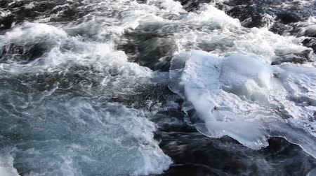 iluminado para trás : Stormy stream of water in the river in the spring in back lit, Chemal River, Altai, Russia Stock Footage