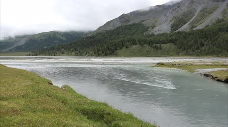 Akkem River flowing into Lake Akkem on a cloudy morning, Altai Mountains, Russia