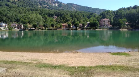Small lake on south Italy. House, treess on lake shores.