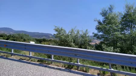 Italy motion footage from car driving. Road barriers view. Outdoor footage.