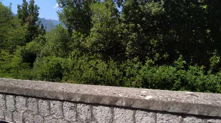 Italy motion footage from car driving on the road stone barrier view. Outdoor footage.