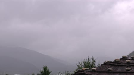 bhutan : Time lapse video of clouds rolling by the rural countryside Stock Footage
