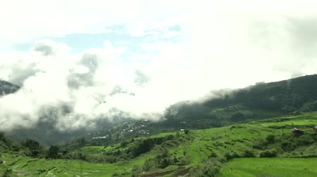 bhutan : Time lapse video of clouds rolling by the country hillside
