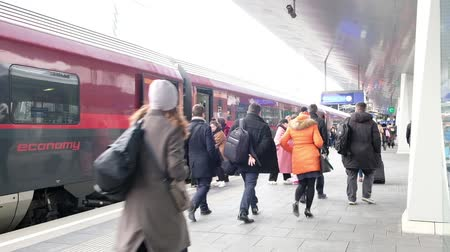 BUDAPEST, HUNGARY- JANUARY,2019: People at railway station going to the train RAILJET