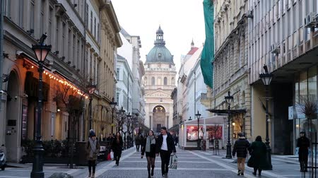 budapeste : BUDAPEST, HUNGARY- JANUARY,2019: People going along the street at St Stephans Basilica