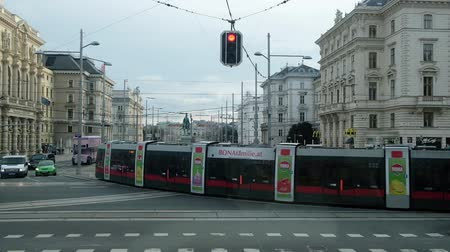 VIENNA, AUSTRIA - JANUARY 21, 2019 : Tramway and cars moving at crossroads