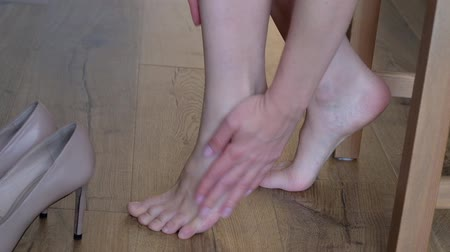 Foot Skin Care. Close Up Of Female Hands Applying Cream, Lotion to her legs and foots. Beauty And Body Care Concept