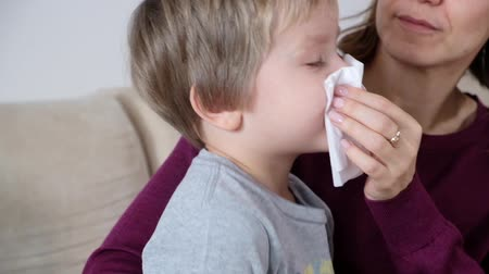 Mother and little boy with running nose, mom taking care of her sick toddler boy. Vídeos