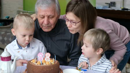 шестидесятые годы : Grandfather Blows Out Birthday Cake Candles At Family Party, Celebrating Birthday Стоковые видеозаписи