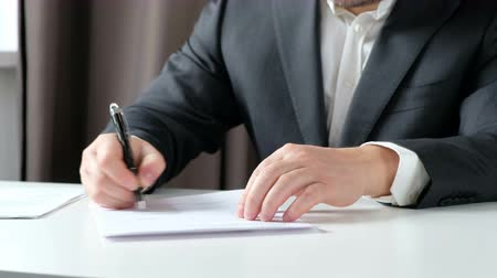 Real estate broker and customer shaking hands after signing a contract: real estate, home loan concept. Close up Wideo