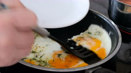 Somebody put fried eggs on a plate, close up