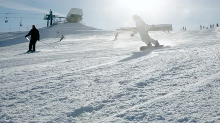 snowboard : Skiers and Snowboarders going down the slope
