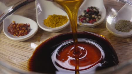 saborear : Close-up of the preparation of the marinade with soy sauce and honey for chicken