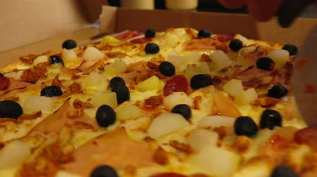 repast : Close-up of a special knife cuts the hot pizza with black olives