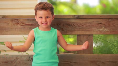 мышцы : boy shows his muscles outdoors in summer day