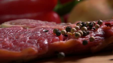говядина : Mixture of peppers falling on a meat beef steak