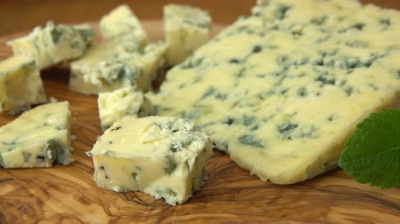 pieces of cheese : Cubes of blue Roquefort cheese. Circular movement of camera Stock Footage