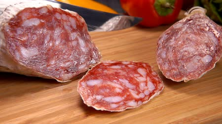 antre : Camera movement near uncooked jerked sausages on a wooden board