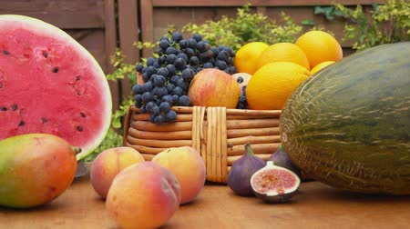 grape basket : Camera movement along a still-life of fresh fruit on a wooden table Stock Footage