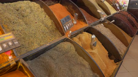 tasting : Panorama on the showcase with oriental spices in the vegetable market Stock Footage