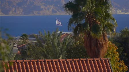 прапорщик : Flag Of Israel fluttering against the bright blue sea