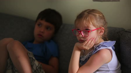 watch tv : Boy and girl watch tv Stock Footage