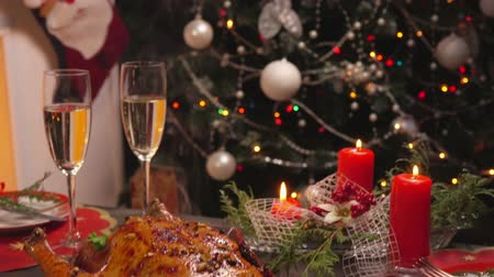 garnished : Serving a festive table on the background of the Christmas tree. Dish with cooked chicken