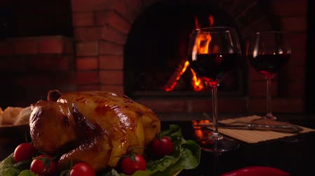 garnished : Celebratory dinner by the fireplace. Panorama from top to bottom on a table with glasses of red wine.