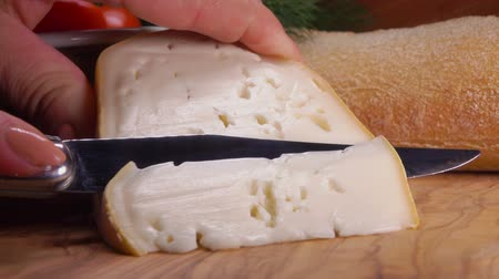 moldy : The knife cuts off a piece of soft sheeps cheese from whole milk Stock Footage