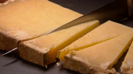 rokfort : Hard French Parmesan cheese cut into triangles on a stone board