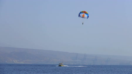 padák : Motor boat tows a special parachute over the sea, sea resort, entertainment