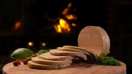 quebradiço : Panorama of chopped foie gras, greens and lingonberries on the background of a burning fireplace Stock Footage
