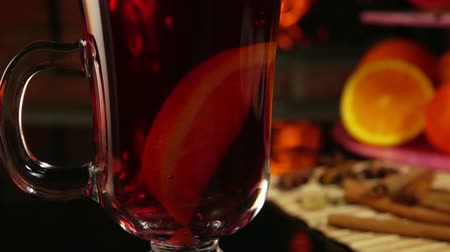 mulled wine : Orange slice falls into the top cup of mulled wine, slow motion
