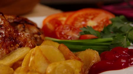 natural spicy : Close-up view on a plate with fried chicken wings, fries and ketchup Stock Footage