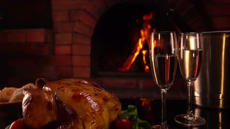 garnished : Celebratory dinner by the fireplace. Panorama from top to bottom on a table with glasses of Champagne Stock Footage