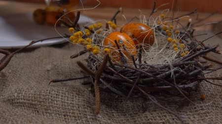 fürj : Festive Easter table setting: Yellow colored quail eggs are laid in the Easter nest