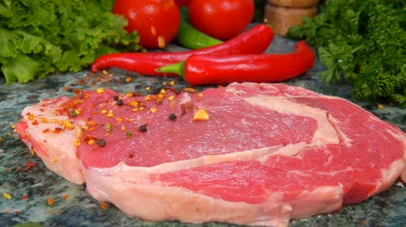 송아지 고기 : Veal steak is sprinkled with a mixture of spices in slow motion