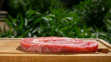 peppercorn : Pork steak falls on a wooden board on a picnic table