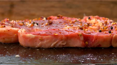 lombo de vaca : Closeup of a steak hissing and frying on hot surface of the stone grill