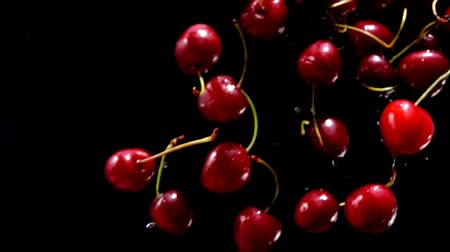 sweet cherry : Rpe cherries fly on a black background closeup in slow motion
