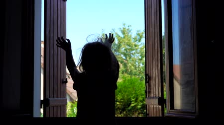 aberto : Girl jumping on the bed against the background of the open window in the early morning Stock Footage