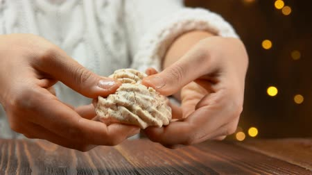 migalhas : Hands break meringue cookies into pieces and crumbs fly to the table Stock Footage