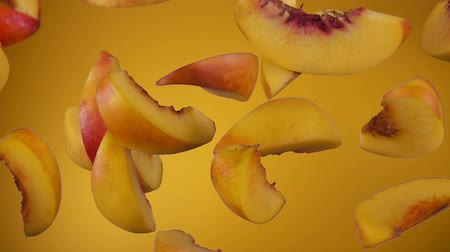 Delicious juicy slices of peaches bounce on a yellow background close up in slow motion Stock mozgókép