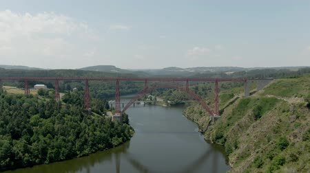 Aerial shot of the Viaduc de Garabit in France. Beautiful railway bridge over the river between the hills
